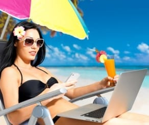 girl-on-beach-with-laptop